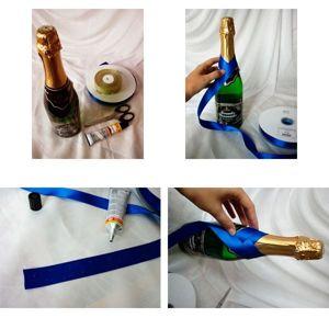 Берем бутылку и прикладыванием ленты к горлышку отмеряем ее нужную длину для первого оборота. Отрезаем ленту. Ставим на ней мелкие клеевые точечки. Смазанный клеем отрезок ленты оборачиваем вокруг бутылки.