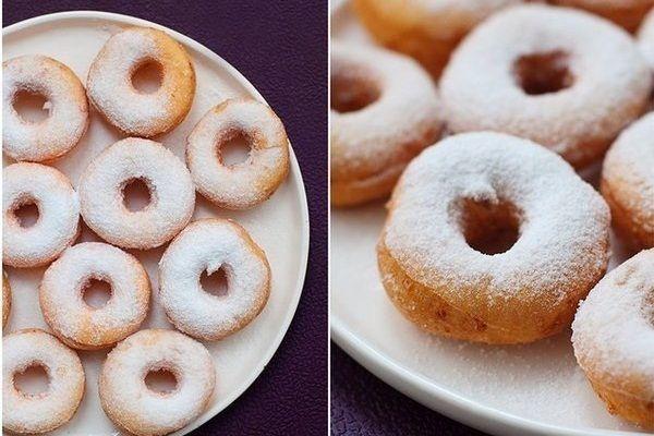 Пончики или пампушки с сахарной пудрой - это десерт для постного ужина. Если приготовить пампушки с чесноком, то их можно подавать к борщу.