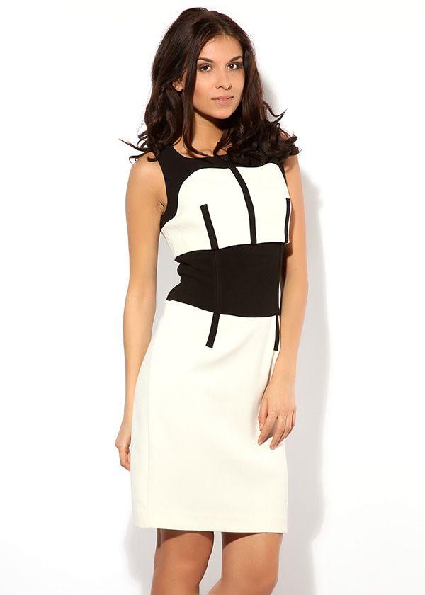 Эффектное белое платье Армани без рукавов, декорировано чёрными вставками. Сзади – потайная застёжка-молния и большая шлица.