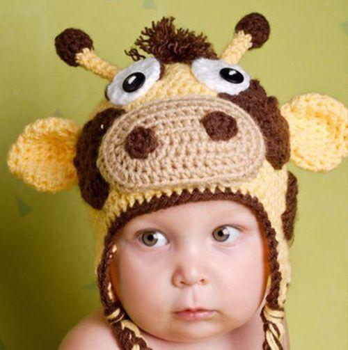 На мой взгляд, очень обаятельная и весёлая шапочка. Или это сказывается моя любовь к коровам)) А взгляд у ребёнка подходит форме головного убора!
