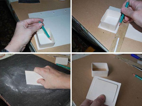 Для изготовления крышки поставьте заготовку на картон и обведите внутреннюю часть. Получится прямоугольник чуть меньше шкатулки. Таких прямоугольников вырежьте 3-5 шт. и склейте их между собой. Снова поставьте заготовку на картон и обведите снаружи, чуть больше, чем шкатулка. Таких прямоугольников тоже сделайте 3-5 шт. и склейте их между собой. Края получившихся крышек заточите на наждачной бумаге. Склейте две части крышки между собой. Крышка готова.