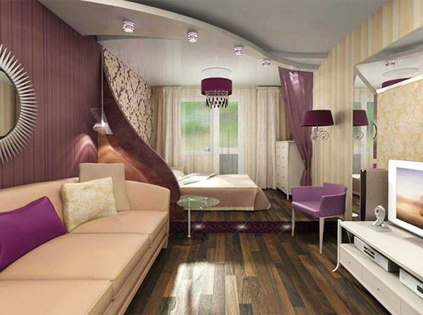 Разграничение комнаты на зоны выполнено с помощью подиума с подсветкой и многоуровневого потолка.