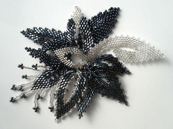 Красивый и стильный цветок, который можно использовать как брошку или как заколку для волос, а можно закрепить его на ободке.