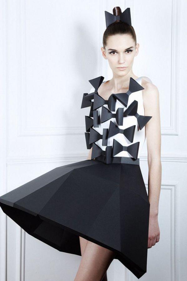 Идея сделать платье из бумаги стара как мир. Однако способы ее реализации появляются все новые. Строгое и интересное бумажное платье, жаль, что недолговечное.
