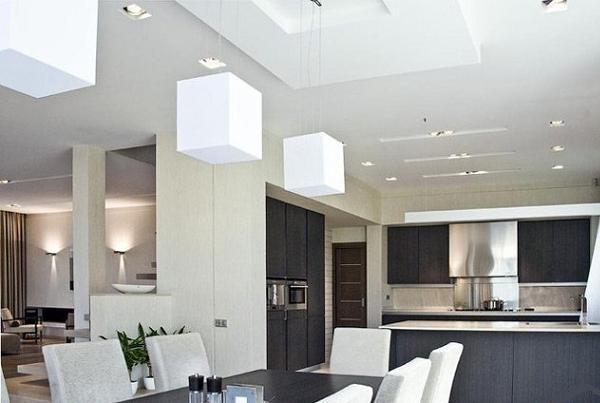 Мебель на кухне однотонная темного цвета и гармонично смотрится с основным белым цветом в интерьере.