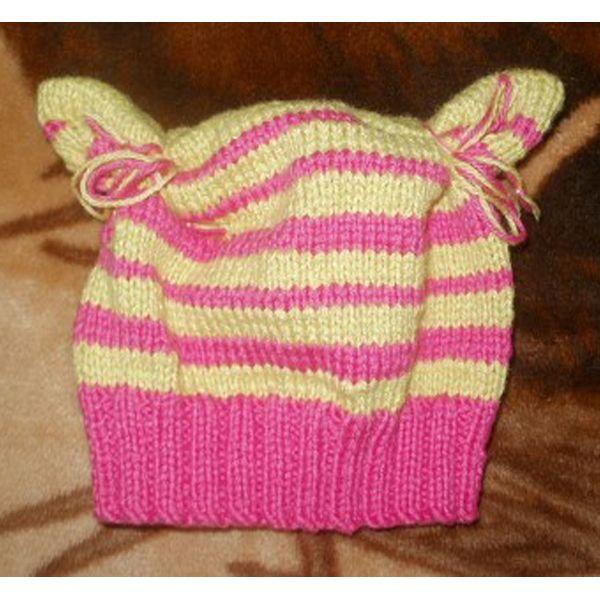 Это вариант шапочки из прямоугольников для девочки. В ярких тонах она заиграла совершенно новыми красками.