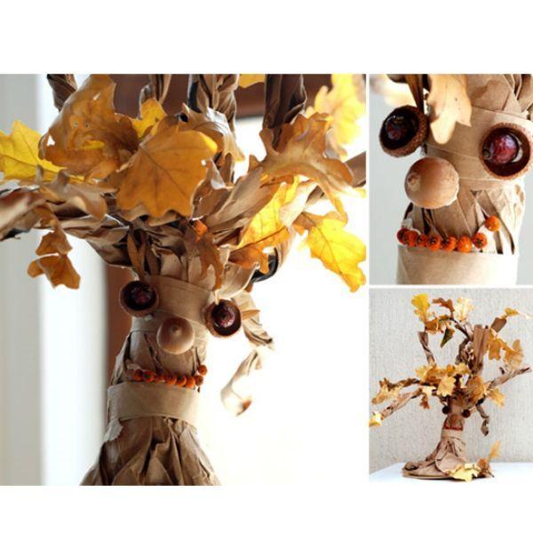 При помощи клея или пластилина прикрепляем дубовые листья и семена клена к веткам. Лучше всего заранее сформировать небольшие «букетики», чтобы крона получилась пышнее.