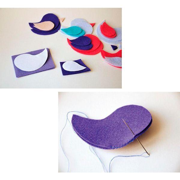 Делаем бумажную выкройку туловища, крылышек и клюва птички. Вырезаем детали из фетра разных цветов. Соединяем стороны петельным швом.