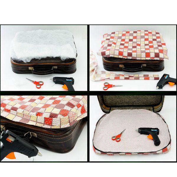 Положить на крышку чемодана синтепон, далее ткань( заранее выкроенную и отделанную полоской ткани). Внутри чемодана, также все отделать утеплителем и тканью. Все приклеить или прошить.