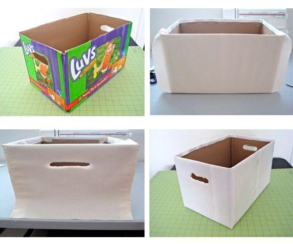 По бокам коробки сделайте отверстия. Обтяните коробку тканью. Используйте двусторонний скотч.