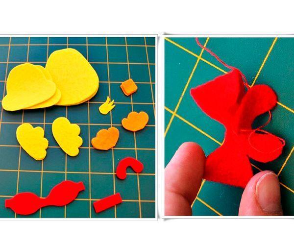 Из красного фетра делаем объемный бант. Остальные детали сшиваем между собой попарно, набивая синтепоном.