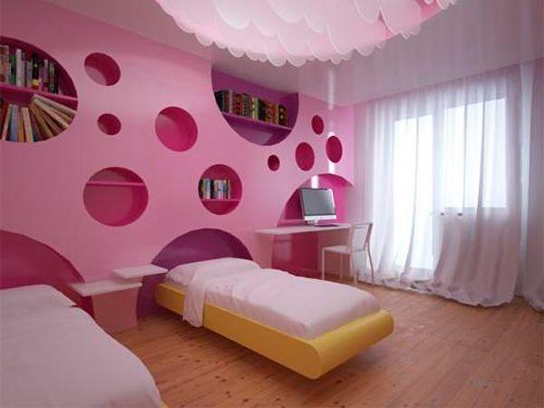 Асимметричные круглые ниши в стене могут служить стильным элементом декора. Кроме того, они довольно функциональны. Ведт в них можно хранить фотоальбомы, вазочки и прочие необходимые вещи.