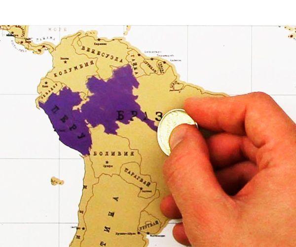 Стирающаяся карта мира пригодится путешественникам. Она вся покрыта золотистым напылением, которое можно стирать монеткой.