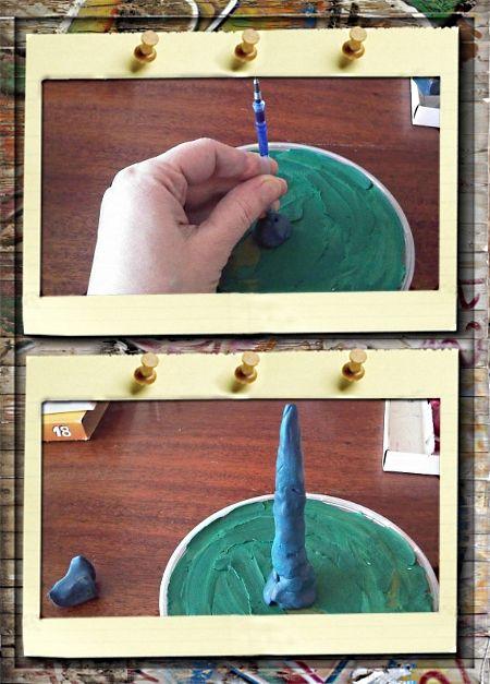 5. Елочка.  Возьмем крышечку от майонезного ведерка и замажем ее пластилином зеленого цвета. В самой серединке прилепим такой кусочек пластилина. Закрепим старый стержень , это будет основа для ствола.  Облепим стержень пластилином любого цвета.
