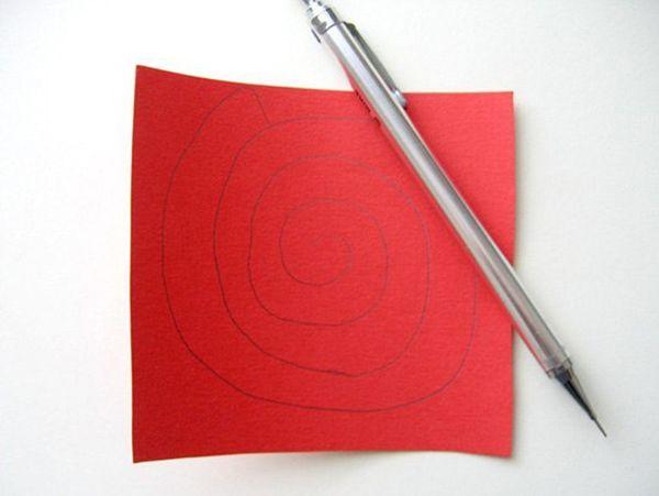 Надо нарисовать простым карандашом на красной цветной бумаге спираль Архимеда.