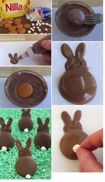 8.Шоколадные зайцы. Выложите шоколадную массу в виде головы зайца на пергамент. Обмакните печенье в шоколад – это будет тело нашего зайца. Хвостик сделайте из кусочка зефира.