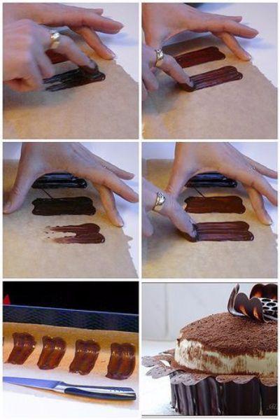 14.Шоколадные лепестки. Работа с шоколадом производится только с помощью рук. Наносим растопленный шоколад на бумагу и слегка ее сворачиваем.
