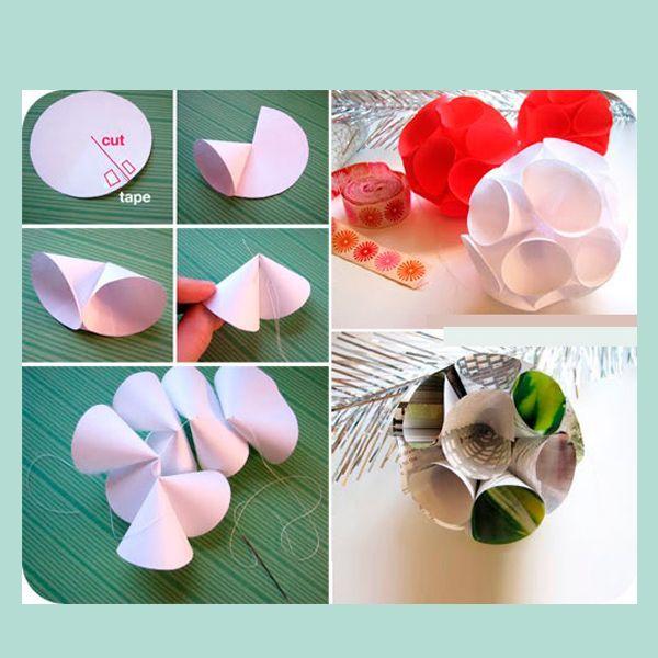 Для следующей игрушки вырежьте десять кружочков одинакового размера. Надрежьте каждый кружочек по радиусу (см. изображение выше) и, используя двойной скотч, закрепите полученные концы, завернув их внутрь.