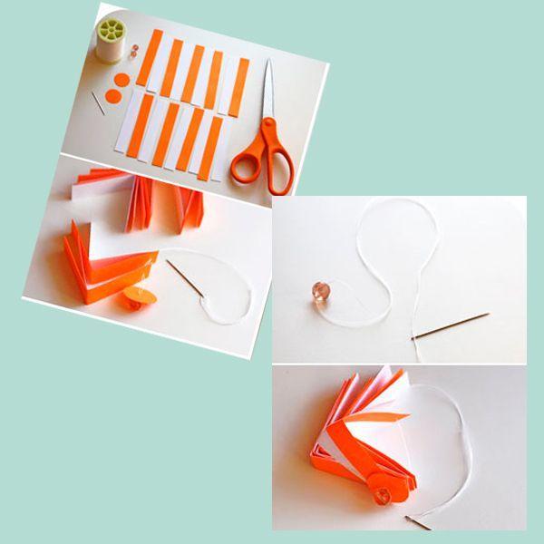 Нужно нарезать полоски разного цвета, по 9 штук каждого, если вы решили делать из двух оттенков, но можно сделать позитивный разноцветный шарик, два кружочка для верхушек игрушки и две бусинки, а также нитка и тонкая игла.
