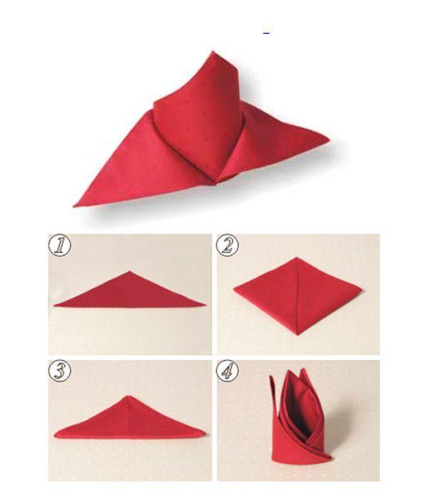 Выполните действия, показанные на фото 1-3. Фигуру поверните. Смотрящие вверх острые углы оттяните соответственно вправо и влево. Поставьте салфетку вертикально.