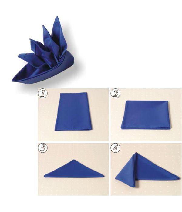 Салфетку сложите пополам (сгиб справа). Прямоугольник сложите еще раз пополам. Нижнюю половину согните по диагонали вверх. Левый угол загните вперед. Правый угол так же загните вперед.