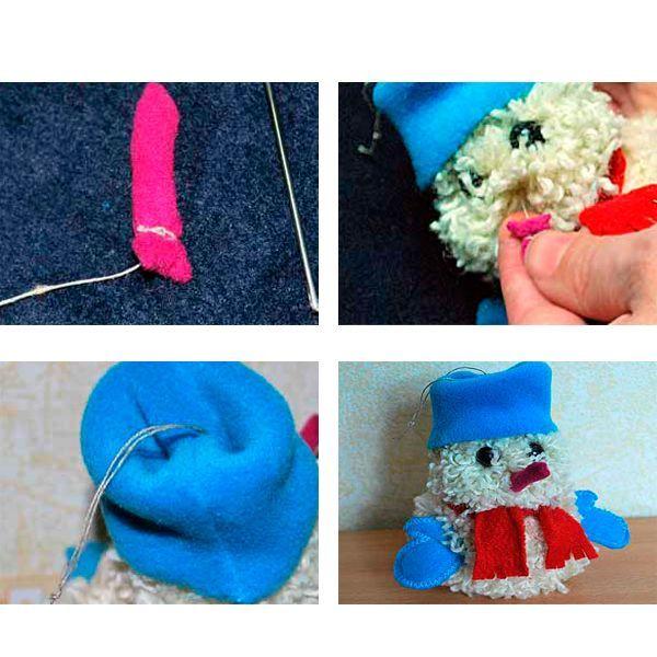 Из оставшейся нити делаем петельку, за которую снеговика можно будет повесить на елку в качестве елочной игрушки. Пришиваем глазки, рукавички, нос.