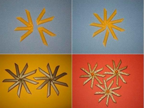 Макароны с помощью горячего клея необходимо склеить между собой так, чтобы получилась снежинка. Окрасить фигурку золотистой акриловой краской. Из тесьмы сделать петельку для подвешивания. Игрушка готова!