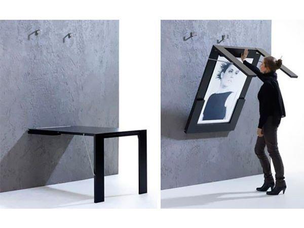 Откидной столик можно спрятать за картиной. И удобно, и функционально, и очень красиво, не правда ли?
