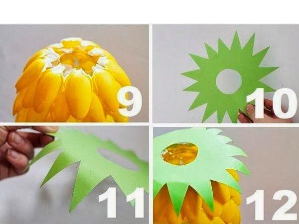 Когда вся бутылка будет обклеена, из цветной бумаги зеленого цвета делаем верхушку ананаса.
