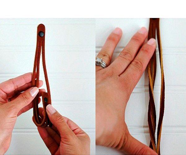 Широкую полоску кожи разрежьте двумя линиями вдоль, а на концы с помощью шила поставьте кнопки.