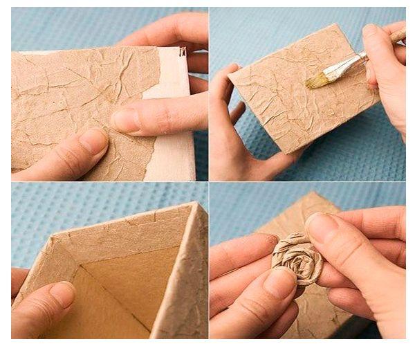Тонкой бумагой обклейте коробку, слегка приминая ее, образовывая складки. Из бумаги скрутите розочку и приклейте ее к поверхности.