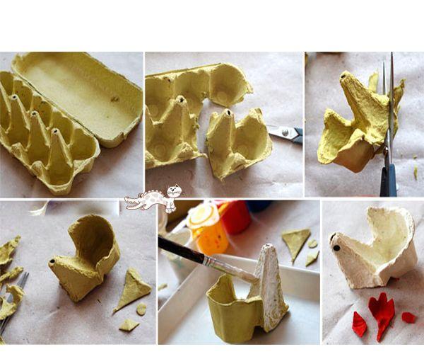 Вырежем подставочки так, как показано на фото. Из цветной бумаги сделаем гребешок и клюв. Приклеим их к подставке. Готово!