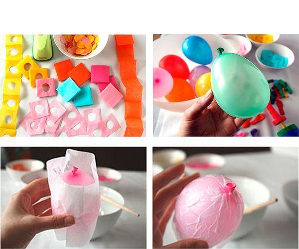 Цветную бумагу разрежем на длинные полосы шириной около трех сантиметров. Сложим гармошкой в несколько раз. Проколем дыроколом и разрежем на квадратики. Надуем шарики, обклеим белой бумагой.