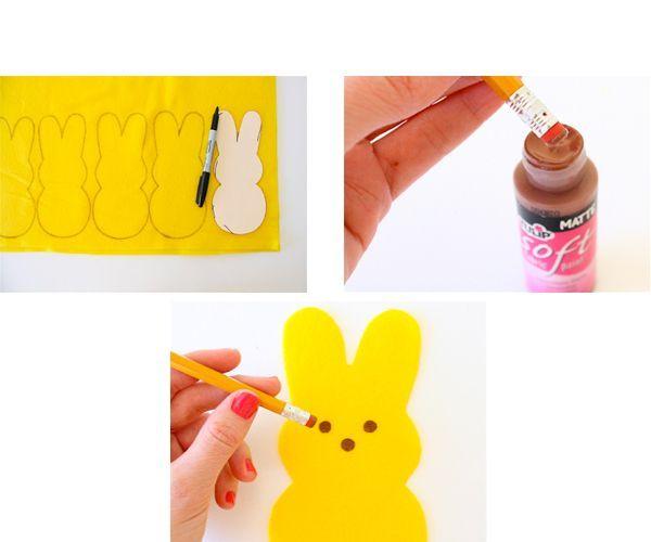 По шаблону выкраиваем зайцев. Окунаем в краску резинку и ставим точки: глазки и нос.