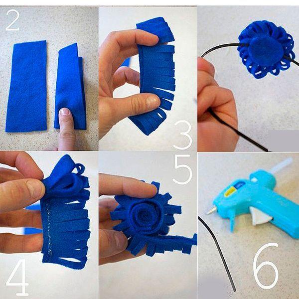 Согните каждый отрезок пополам и нарежьте на полосы шириной около 0.5 см. Скрутите цветок, край зафиксируйте термоклеем.
