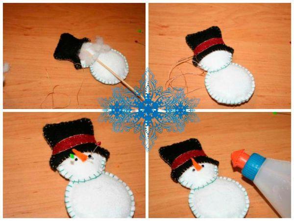 Красными нитками вышейте ротик снеговику. Туловище снеговика украсьте снежинками. Цвет снежинок может быть разным. Сделайте их тем цветом, который вам по душе.