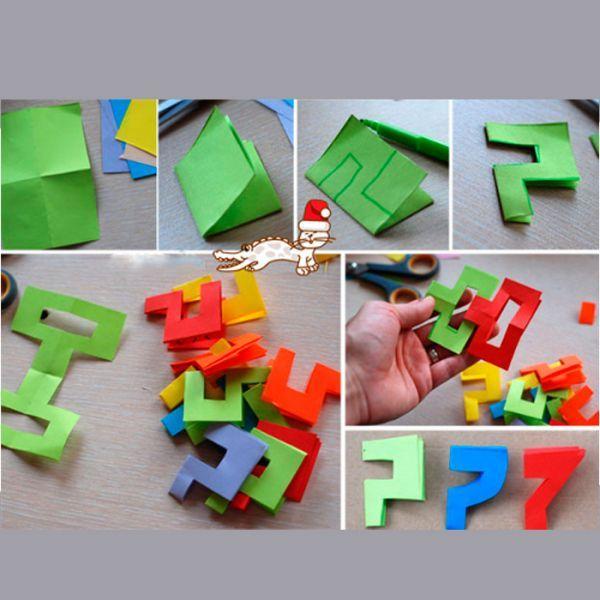 Лист бумаги необходимо сложить пополам. Нарисовать будущую деталь так, чтобы была задействована сторона сгиба. Ее ни в коем случае нельзя разрезать - деталь должна быть двойной. Соединяем детали между собой так, как показано на этом фото.