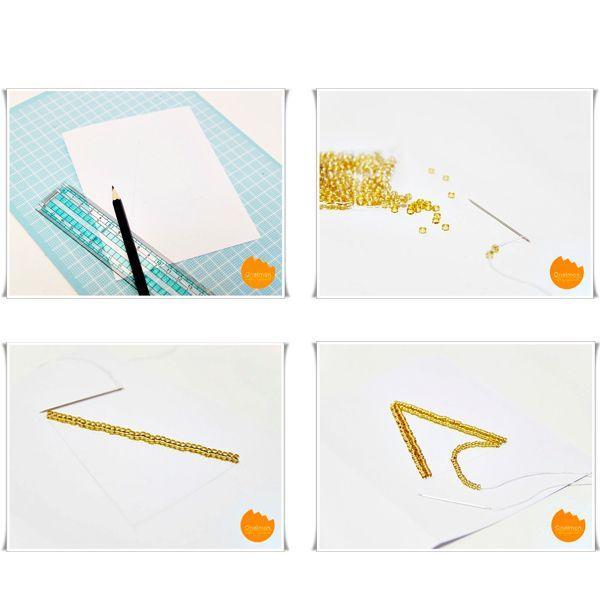 Подготовьте основу. Сложите лист картона пополам, края закруглите. На нитку наберите мелкий бисер.