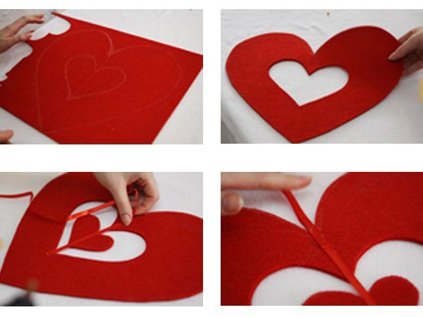 Намечаем на фетре и вырезаем большое сердце. Внутри него рисуем еще два сердца: среднего размера и маленькое, выкраиваем. Среднее сердце послужит выемкой для маленького.