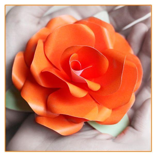 Такая роза из бумаги может стать прекрасным украшением интерьера или элементом подарочной упаковки.