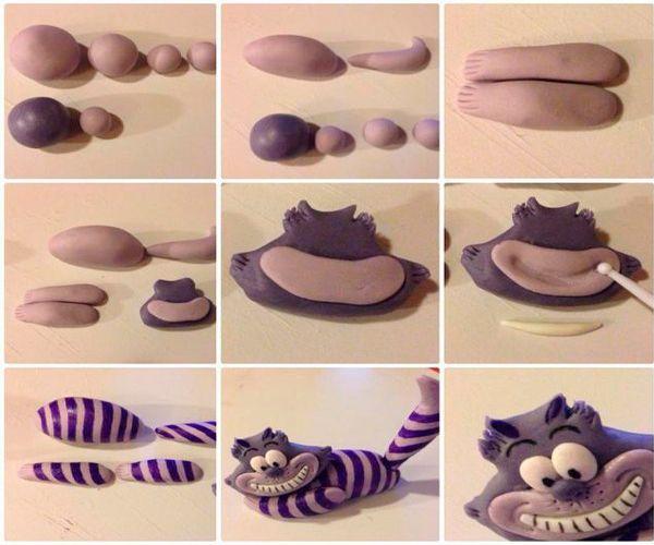 Из темной пластики сделайте голову кота, используя нож для придания формы. Улыбку сделайте из более светлой пластики. Сделайте глаза. Из черного пластика сделайте полосы на туловище.